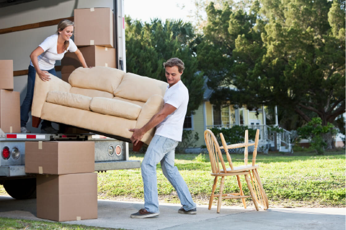 Man and a woman moving a couch into a moving truck ...  sc 1 th 183 & Self Storage Units | Storage Facilities at Bangor Area Self Storage